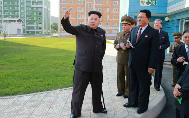 Kim Jong-Un, left, on a tour of new housing complex in Pyongyang.