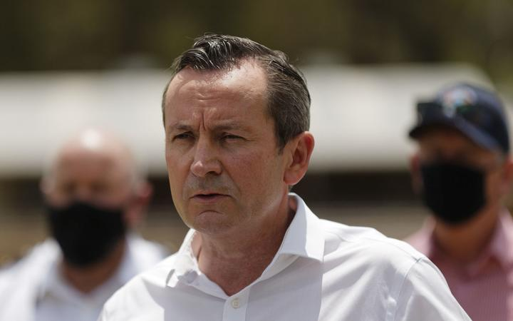 Western Australia state Premier Mark McGowan (C) speaks to media announcing that 72 homes have been destroyed by fires, in Perth on February 3, 2021. (Photo by Trevor Collens / AFP)