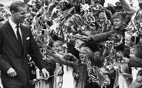The Duke of Edinburgh Prince Philip is greeted by cheering children at Waipukurau, during the first Royal visit to New Zealand in 1953.