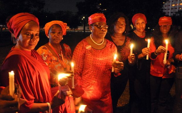 Campaigners for the release of abducted Chibok schoolgirls at a vigil in Abuja, Nigeria.