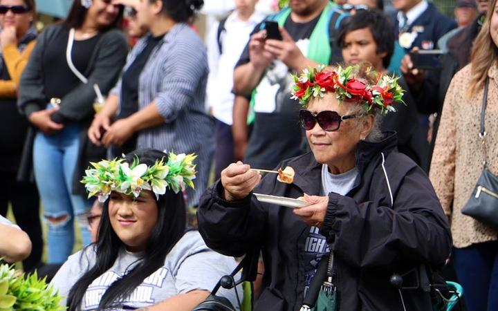 Cook Island mama enjoying a meal while watching performances - day 2 Polyfest 2021
