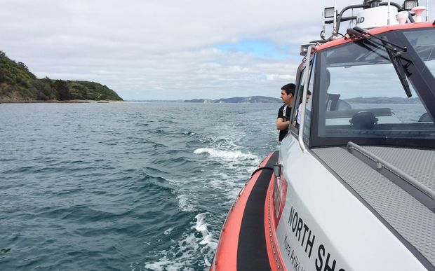 Coastguard crew look for the missing boat north of Auckland.
