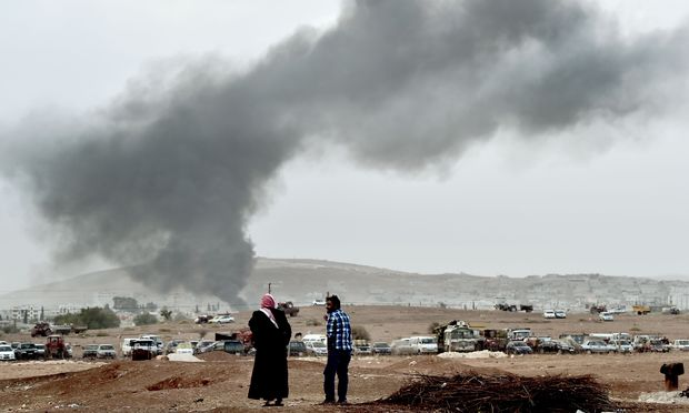 Smoke rises from the Syrian town of Kobane after air strikes yesterday.
