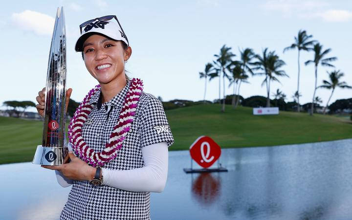 Lydia Ko poses with the trophy after winning the LPGA LOTTE Championship at Kapolei Golf Club in Hawaii.