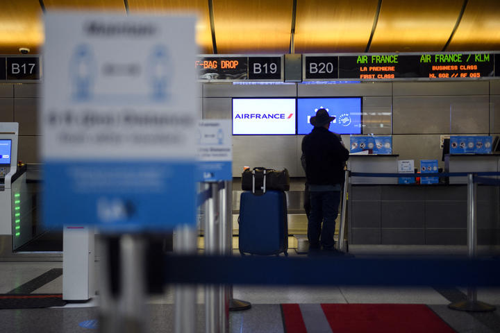 A passenger checks in for a flight at the Air France and KLM counter  at Los Angeles International Airport in January 2021.