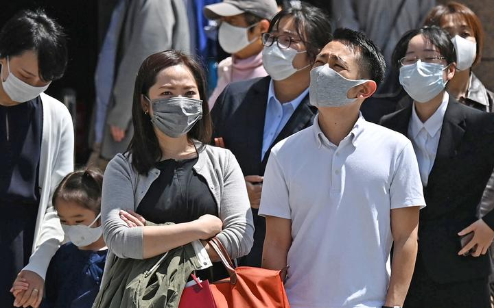 People wearing face masks are seen at Ginza district in Chuo Ward, Tokyo on April 20, 2021, amid a pandemic of the new coronavirus COVID-19.