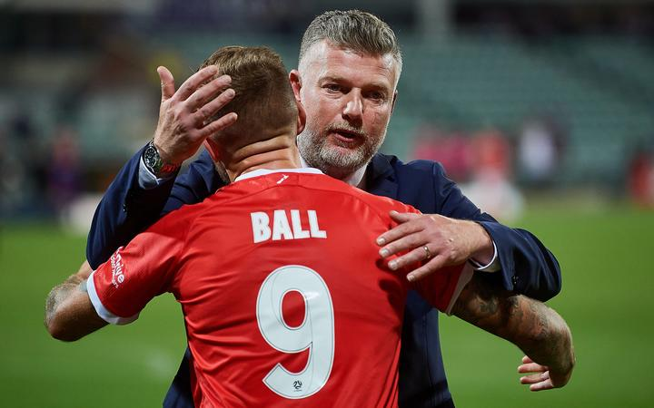 Wellington Phoenix coach Ufuk Talay congratulations striker David Ball following their 3-1 win over the Perth Glory at HBF Park on April 18 2021 in Perth, Australia.