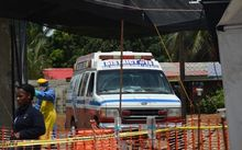 An ambulance arrives at NGO's Medecins Sans Frontieres Ebola treatment center inside the Samuel K Doe stadium in Monrovia on 15 October.