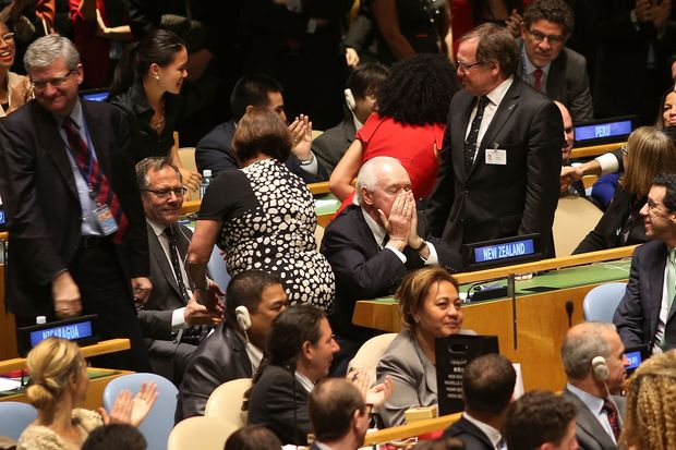 New Zealand's Jim McLay (centre) reacts after New Zealand was elected as a non-permanent member of the Security Council.