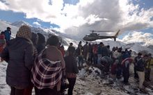 A Nepalese Army helicopter rescues survivors.