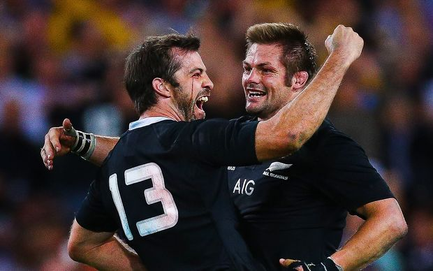 Conrad Smith embraces New Zealand captain Richie McCaw to celebrate the All Black's last minute victory over the Wallabies.