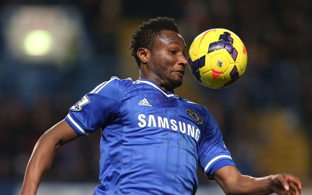 Chelsea player tries to control the ball.