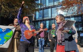 Singers protest outside Canterbury Regional Council office.