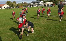 A British researcher says rugby has become too dangerous for children to play.