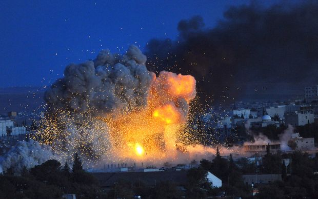 Smoke and flames rise following an explosion in the Syrian town of Kobane, seen from southeastern Turkey.