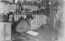 Self portrait of surgeon George Murray Levick's cubicle in his hut at Cape Adare.