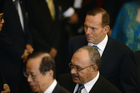 Peter O'Neill between Australian Prime Minister Tony Abbott and former Japan Prime Minister Yasuo Fukuda at the swearing in ceremony of Indonesia's Joko Widodo.