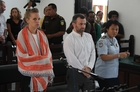 French journalists Valentine Bourrat and Thomas Dandois accompanied by an interpreter, face trial before a court in Jayapura in Indonesia's eastern Papua province.