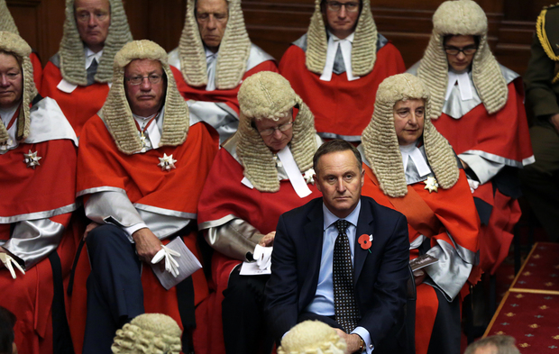 Prime Minister John Key sits in front of the High court judiciary during the official opening of Parliament
