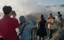 Chinese tourists visiting geysers in Rotorua.