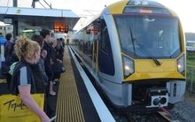 Commuters wait to board a south-bound train. A new timetable at the end of the year is expected to boost weekend services.