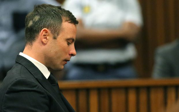 Oscar Pistorius reacts to hearing that he is to spend the next five years in jail.