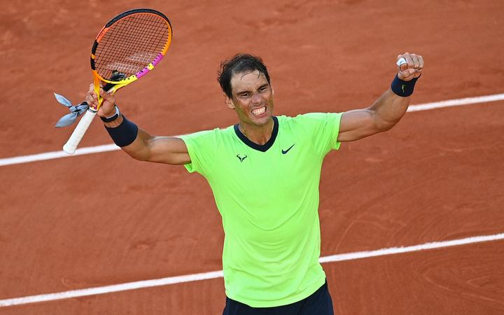 Spain's Rafael Nadal celebrates after winning against Italy's Jannik Sinner during their men's singles fourth round tennis match at the French Open tennis tournament in Paris on June 7, 2021.