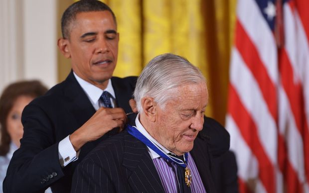 President Barack Obama presents the Presidential Medal of Freedom to former Washington Post executive editor Ben Bradlee in 2013.