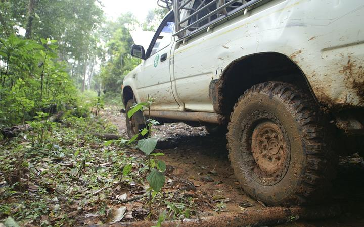 15205812 - closeup of 4x4 car driving uphill with mud
