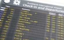 departures sign blurred