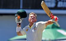 David Warner of Australia celebrates after scoring a century.