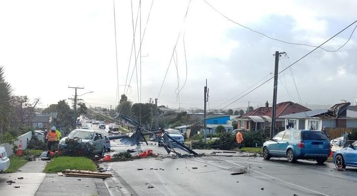 Downed powerlines and damaged roofs after yesterday's tornado.