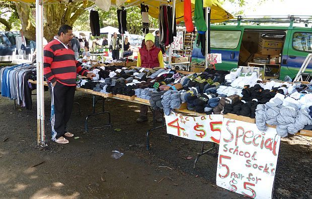 Socks pilled up on long trestle at stall at Auckland's Avondale Market