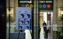 A health alert is displayed at the entrance to Bellevue Hospital where Dr Craig Spencer is being treated.