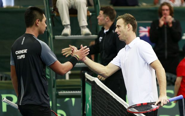 Michael Venus shakes hands with Chieh-Fu Wang after their match