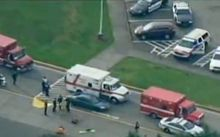 A video grab (courtesy of CNN and KOMO TV News) shows police and ambulances at Marysville-Pilchuck High School.