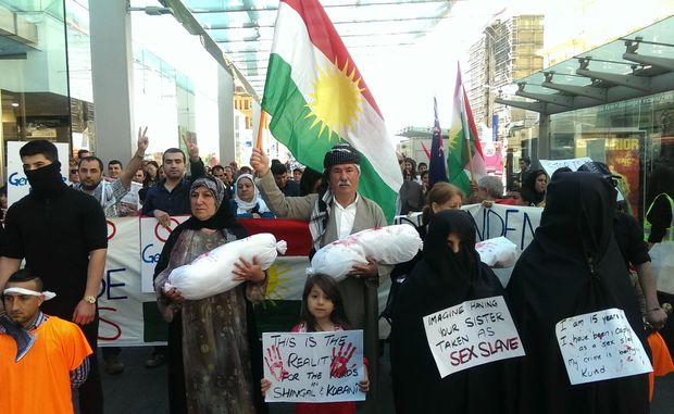 Members of New Zealand's Kurdish community take to the streets of Auckland to demand more humanitarian support and weaponry to fight Islamic State