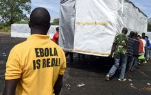Workers setting up a new treatment center as part of the fight against Ebola in Liberia.