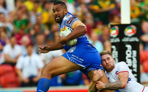 Samoa's Frank Pritchard is tackled by Sam Tomkins