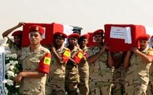 Coffins are carried in the funeral for 30 solders killed in the latest outbreak of violence in the Sinai Peninsula.
