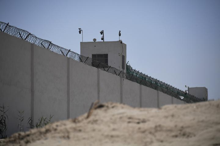 This photo taken on May 31, 2019 shows the outer wall of a complex which includes what is believed to be a re-education camp where mostly Muslim ethnic minorities are detained, on the outskirts of Hotan, in China's northwestern Xinjiang region.