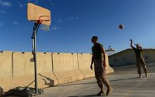 US Marines play basketball as British and US troops prepare to withdraw from the Camp Bastion-Leatherneck complex in Helmand province.