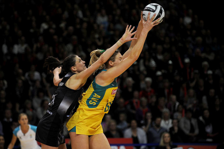 Caitlin Bassett of Australia catches the ball under pressure from Anna Harrison in 2016.