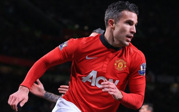 Robin van Persie of Man Utd peels away as he celebrates after scoring.