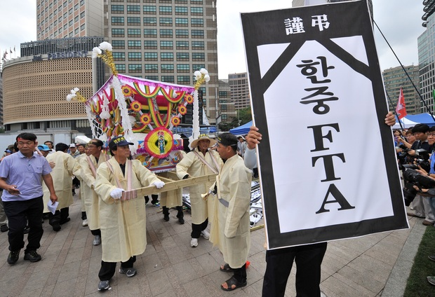 South Korean farmers and fishermen carry a coffin as they protest in Seoul in 2012 against a proposed free trade deal with China. Talks with both New Zealand and China are still going on.