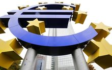 Symbol of the euro outside the headquarters of the European Central Bank, Germany.