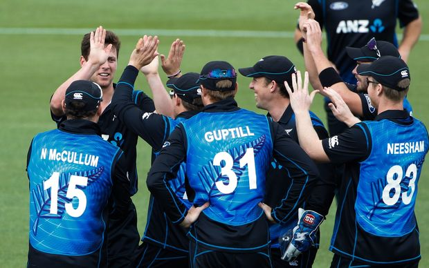 The Black Caps congratulate bowler Matt Henry on one of his wickets