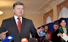 Ukrainian President Petro Poroshenko speaks to the media during Ukraine's parliamentary elections.