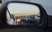 auckland traffic jam through car mirror
