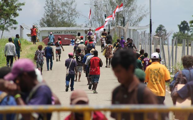 People from Papua New Guinea make frequent trips across the Indonesia border at Wutung